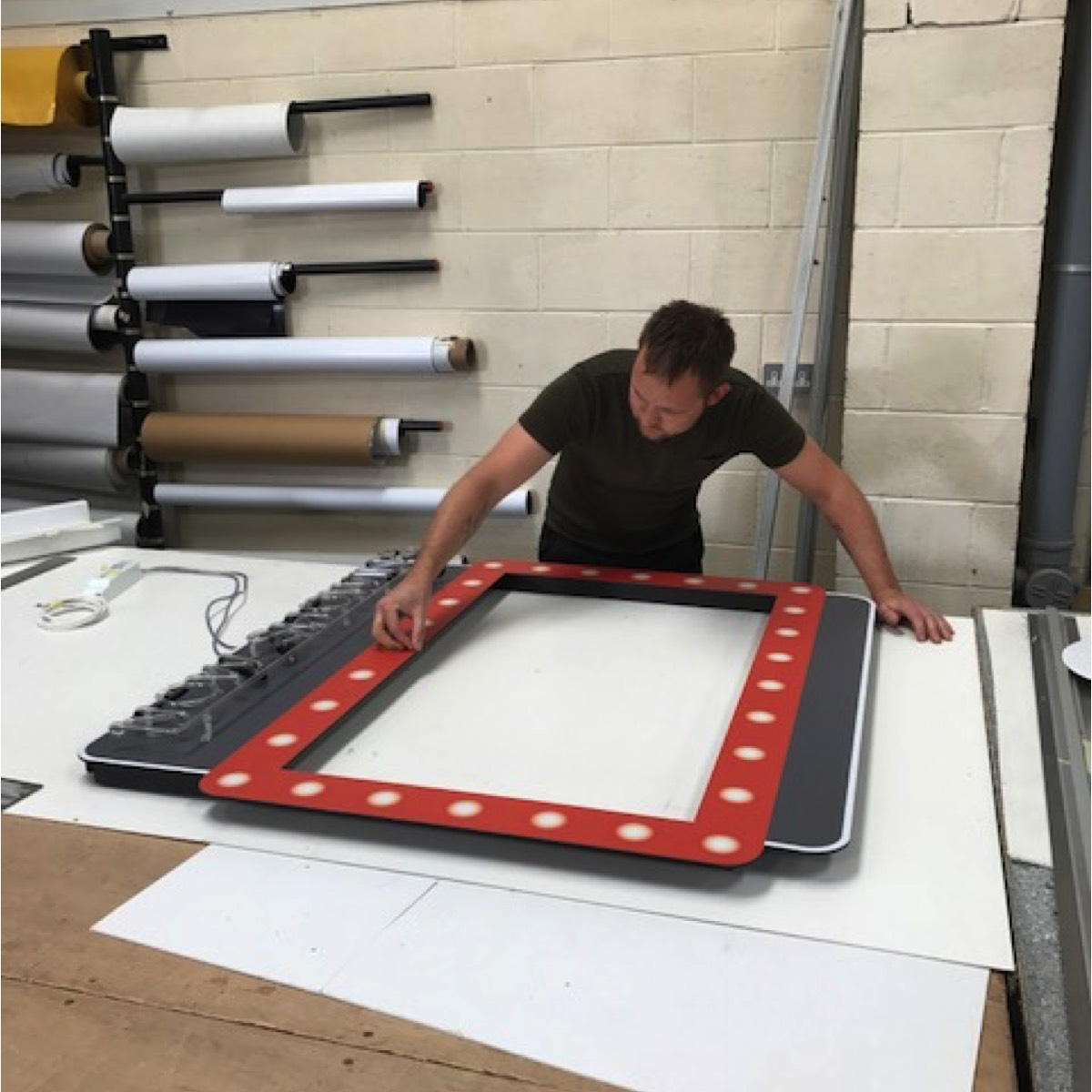neon sign frame being manufactured